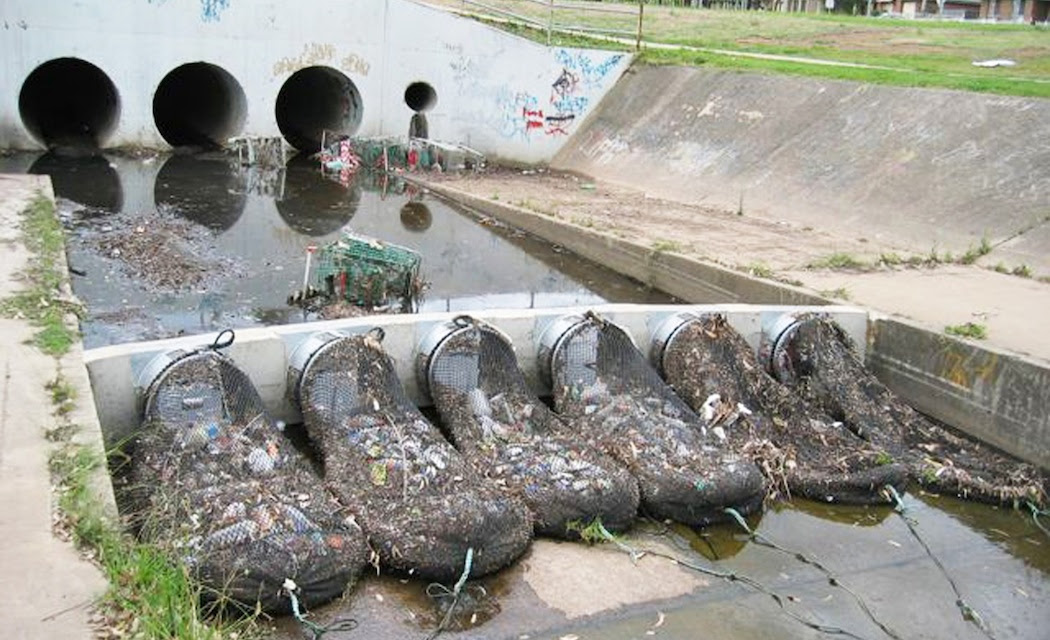 An example of a system of nets for capturing trash in creeks and storm drain channels.